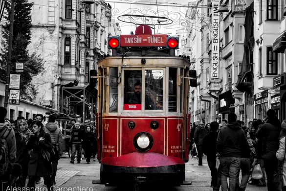 When you walk in the Taksim district in Istanbul, it's full of people and one of the main attractions is to wait for the trams to pass by. Their red color creates a nice contrast with the grey of the buildings and streets.